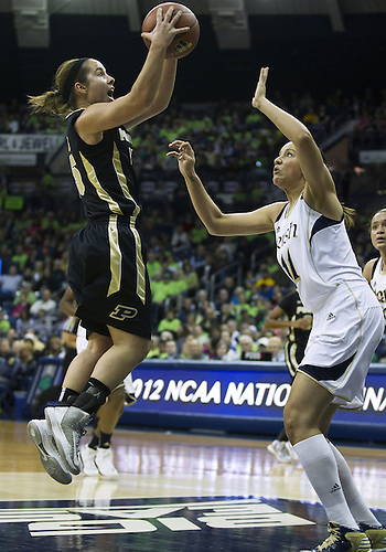 December 29, 2012:  Purdue guard Courtney Moses (15) goes up for a shot as Notre Dame forward Natalie Achonwa (11) defends during NCAA Women's Basketball game action between the Notre Dame Fighting Irish and the Purdue Boilermakers at Purcell Pavilion at the Joyce Center in South Bend, Indiana.  Notre Dame defeated Purdue 74-47.