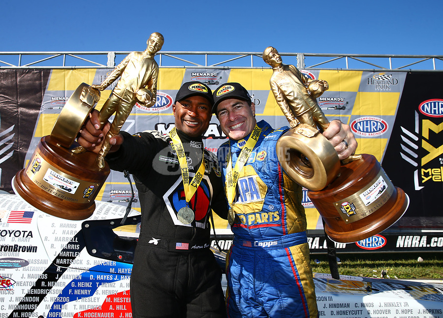 May 21, 2017; Topeka, KS, USA; NHRA top fuel driver Antron Brown (left) and funny car driver Ron Capps celebrate after winning the Heartland Nationals at Heartland Park Topeka. Mandatory Credit: Mark J. Rebilas-USA TODAY Sports