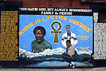 Urban street mural honors the memory of a beloved community leader of the Bedford-Stuyvesant section of Brooklyn, New York - artists are depicted on wall painting along with the names of family and admirers