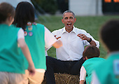 United States President Barack Obama reacts as a group of Girl Scouts approach for a 'group hug' during a campout on the South Lawn of the White House June 30, 2015 in Washington, DC. The president and first lady Michelle Obama hosted the event as part of the first lady's Let's Move! Outside initiative and for Girl Scouts to earn the new Girls' Choice Outdoor badge.  <br /> Credit: Chip Somodevilla / Pool via CNP