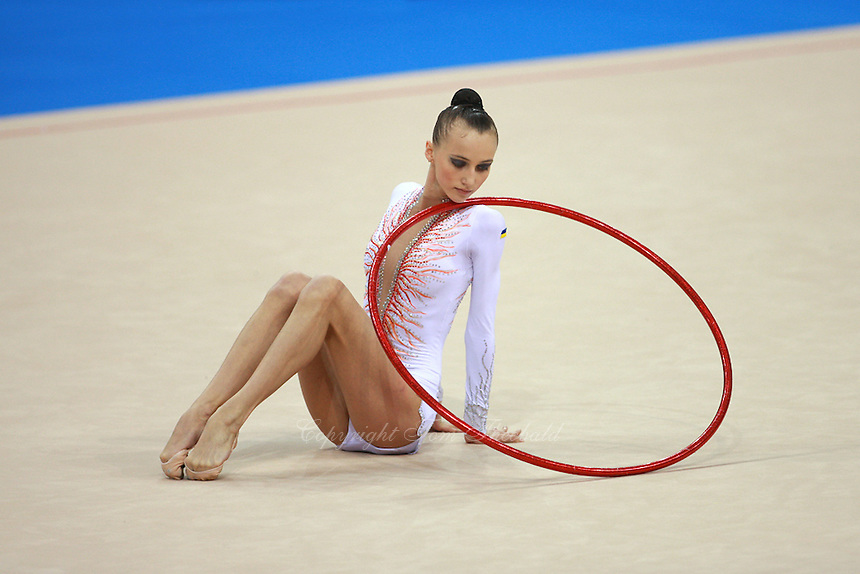 Anna Rizatdinova of Ukraine (junior) begins routine with hoop at  2008 European Championships at Torino, Italy on June 5, 2008.  Photo by Tom Theobald.