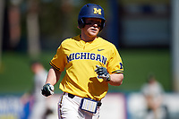 Michigan Wolverines left fielder Miles Lewis (3) runs the bases after hitting a home run during a game against Army West Point on February 17, 2018 at Tradition Field in St. Lucie, Florida.  Army defeated Michigan 4-3.  (Mike Janes/Four Seam Images)