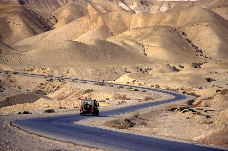 Judean desert hills and road in Israel.