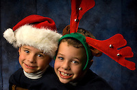 Two boys wear funny hats in anticipation of Christmas.