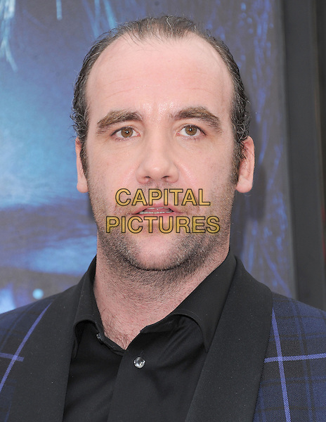 "Rory McCann.""Game Of Thrones"" 3rd Season Los Angeles Premiere held at the TCL Chinese Theatre, Hollywood, California, USA..March 18th, 2013.headshot portrait blue black check suit shirt stubble facial hair .CAP/RKE/DVS.©DVS/RockinExposures/Capital Pictures."