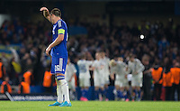 John Terry of Chelsea wipes his forehead as Dynamo Kiev draw level during the UEFA Champions League Group G match between Chelsea and Dynamo Kyiv at Stamford Bridge, London, England on 4 November 2015. Photo by Andy Rowland.