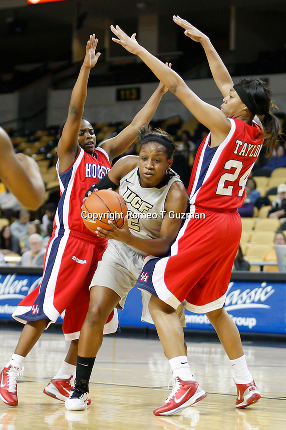 January 27, 2011: Central Florida forward D'Nay Daniels (2) splits two Houston defenders on the way to the basket during first half womens Conference USA NCAA basketball game action between the Houston Cougars and the Central Florida Knights at the UCF Arena Orlando, Fl.