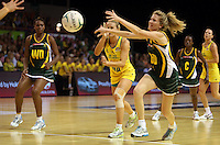 17.10.2012 Australia's Renae Hallinan and South Africa's Karla Mostert in action during the Australia v South Africa netball test match as part of the Quad Series played in Newcastle Australia. Mandatory Photo Credit ©Michael Bradley.