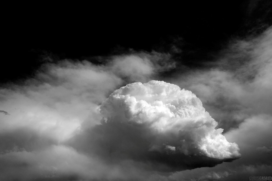 "Cumulonimbus clouds are tall and dense, and involved in thunderstorms and other intense weather. Cumulonimbus means ""column of rain"" in Latin. They form as a result of atmospheric instability. These clouds can form alone, in clusters, or along a cold front in a squall line. They create lightning through the heart of the cloud. Cumulonimbus clouds form from cumulus clouds (namely from cumulus congestus) and can further develop into a supercell, a severe thunderstorm with special features."