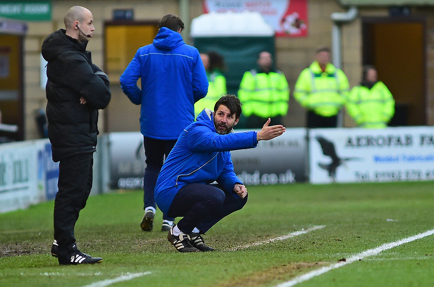 Lincoln City manager Danny Cowley shouts instructions to his team from the technical area<br /> <br /> Photographer Andrew Vaughan/CameraSport<br /> <br /> The EFL Sky Bet League Two - Lincoln City v Forest Green Rovers - Saturday 30th December 2017 - Sincil Bank - Lincoln<br /> <br /> World Copyright &copy; 2017 CameraSport. All rights reserved. 43 Linden Ave. Countesthorpe. Leicester. England. LE8 5PG - Tel: +44 (0) 116 277 4147 - admin@camerasport.com - www.camerasport.com