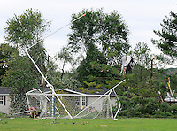 Photo By Kristin Eberts: The marred goalpost sits slanted at Basil Rutter Field at Athens High School in The Plains, Ohio, on the morning of Friday, Sept. 17, 2010. An unconfirmed tornado ripped through The Plains, Ohio Thursday Sept. 16, 2010, causing downed power lines, uprooted trees, overturned mobile homes and significant damage to Athens High School.
