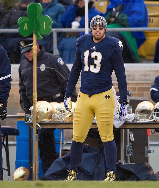 Nov. 23, 2013; Senior Danny Spond (13) watches from the sideline on senior day.<br /> <br /> Photo by Matt Cashore