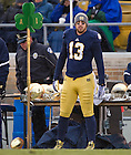 Nov. 23, 2013; Senior Danny Spond (13) watches from the sideline on senior day.<br /> <br /> Photo by Matt Cashore