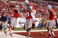 Ohio State Buckeyes defensive lineman Joey Bosa (97) celebrates his touchdown in the second quarter of the Big Ten Championship game at Lucas Oil Stadium in Indianapolis on Saturday, December 6, 2014. (Columbus Dispatch photo by Jonathan Quilter)