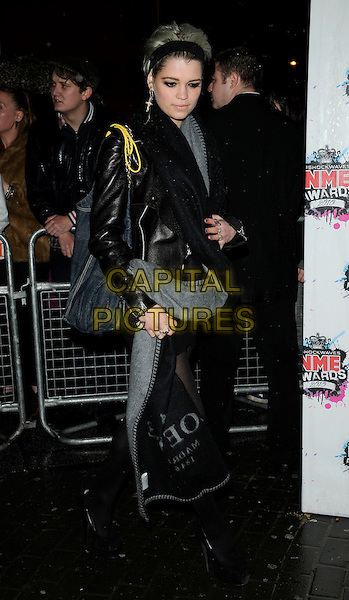 PIXIE GELDOF.The Shockwaves NME Awards 2010 held at Brixton Academy, London, England. .February 24th, 2010.full length black leather jacket side bag.CAP/CAN.©Can Nguyen/Capital Pictures.