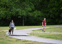 Residents walk Friday, May 15, 2020, on the trail in Gulley Park in Fayetteville. The city has recorded a significant increase in trail users since the coronavirus pandemic hit in mid-March. The trail near Gulley Park has had a monthly average of about 25,000 users, compared to about 14,000 at the same time last year. Visit nwaonline.com/200516Daily/ for today's photo gallery.<br /> (NWA Democrat-Gazette/Andy Shupe)