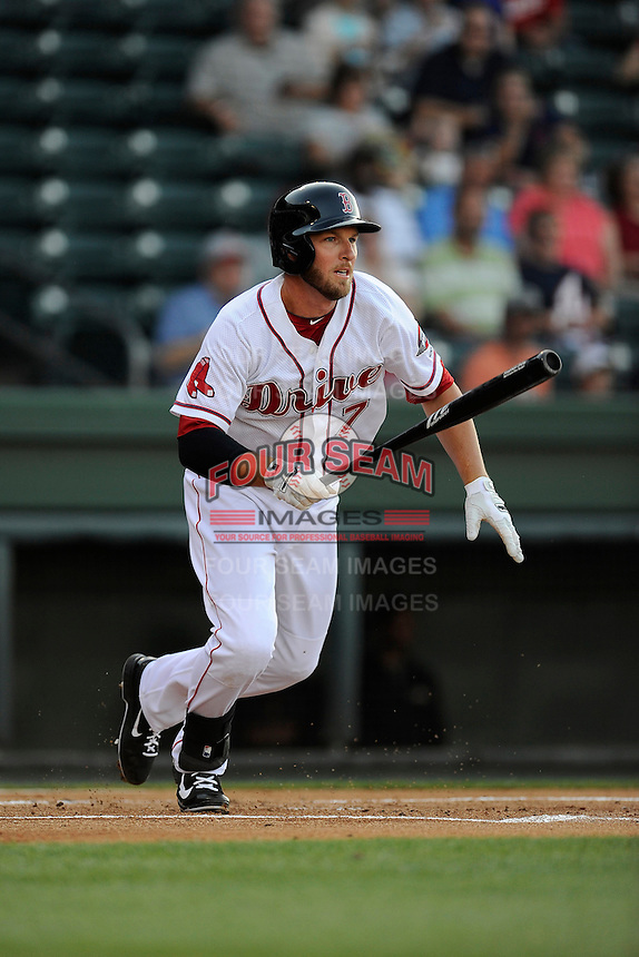 Boston Red Sox shortstop Stephen Drew (7) gets a hit in his first at bat for the Class A Greenville Drive on a tuneup assignment in a game against the Augusta GreenJackets on Friday, May 23, 2014, at Fluor Field at the West End in Greenville, South Carolina. (Tom Priddy/Four Seam Images)