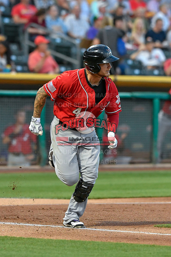 Brandon Barnes (4) of the Albuquerque Isotopes hustles to first base against the Salt Lake Bees in Pacific Coast League action at Smith's Ballpark on August 30, 2016 in Salt Lake City, Utah. The Bees defeated the Isotopes 3-2. (Stephen Smith/Four Seam Images)