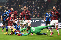 9th February 2020, Milan, Italy; Serie A football, AC Milan versus Inter-Milan;  Andrea Conti of AC Milan sees the chance pushed away from Milan Skriniar by keeper Gianluigi Donnarumma  of AC Milan