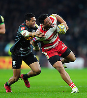 Motu Matu'u of Gloucester Rugby fends Alofa Alofa of Harlequins. Aviva Premiership match, between Harlequins and Gloucester Rugby on December 27, 2016 at Twickenham Stadium in London, England. Photo by: Patrick Khachfe / JMP