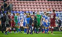 Goalkeeper Loris Karius of Liverpool and other players are approached by spectators on the final whistle during the pre season friendly match between Wigan Athletic and Liverpool at the DW Stadium, Wigan, England on 14 July 2017. Photo by Andy Rowland.