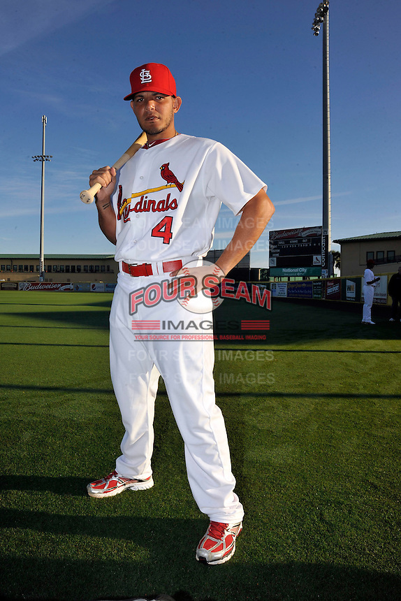 Mar 01, 2010; Jupiter, FL, USA; St. Louis Cardinals catcher Yadier Molina (4) during  photoday at Roger Dean Stadium. Mandatory Credit: Tomasso De Rosa/ Four Seam Images