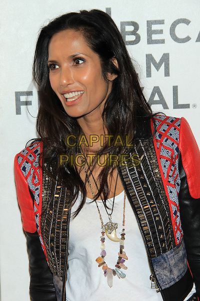 "Padma Lakshmi.attending the 2013 Tribeca Film Festival Premiere of ""Sunlight Jr."" held at the Tribeca Performing Arts Center, New York, NY, USA, .April 20th, 2013..portrait headshot red leather jacket smiling beads gold embellished white vest top necklace .CAP/LNC/TOM.©TOM/LNC/Capital Pictures."