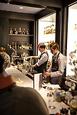USA, Colorado, Aspen, bartenders make apres ski drinks at the bar at Element 47, The Little Nell Hotel