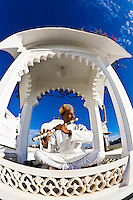 Like something out of Arabian Nights, this amazing flute player played in the morning under a bright blue Indian sky. (Photo by Matt Considine - Images of Asia Collection)