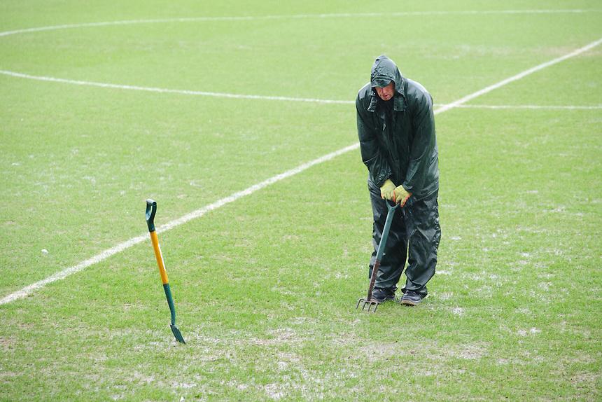 A member of the Fleetwood Town ground staff works on the pitch as Referee Ross Joyce inspects the pitch around 12.30<br /> <br /> Photographer Chris Vaughan/CameraSport<br /> <br /> Football - The Football League Sky Bet League One - Fleetwood Town v Scunthorpe United  - Saturday 20th February 2016 - Highbury Stadium - Fleetwood    <br /> <br /> &copy; CameraSport - 43 Linden Ave. Countesthorpe. Leicester. England. LE8 5PG - Tel: +44 (0) 116 277 4147 - admin@camerasport.com - www.camerasport.com
