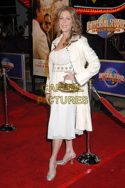 "RITA WILSON.""Charlie Wilson's War"" Los Angeles Premiere at Universal City Walk, Universal City, California, USA,.10 December 2007..full length cream gold beaded dress coat bag.CAP/ADM/BP.©Byron Purvis/AdMedia/Capital Pictures."
