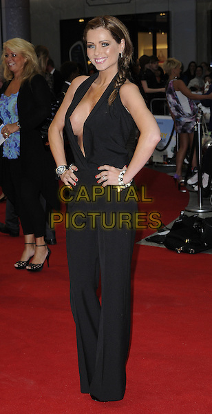 Nicola McLean.World Premiere of 'Larry Crowne' at the Vue Cinema, Westfield Shopping Centre, London, England, UK,.June 6th 2011..full length black low cut cleavage catsuit hands on hips plunging neckline halterneck .CAP/CAN.©Can Nguyen/Capital Pictures.