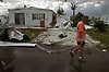 A resident of a triler park walks through the devistation left by Hurricane Charley in Punta Gorda. The resident along with more than 100 other people survived the storm in the communities club house that was built as a hurricane shelter. Eri kKellar