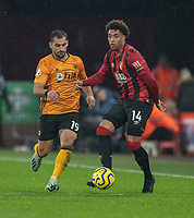 Bournemouth's Arnaut Danjuma (right) under pressure from Wolverhampton Wanderers' Jonny Otto (left) <br /> <br /> Photographer David Horton/CameraSport<br /> <br /> The Premier League - Bournemouth v Wolverhampton Wanderers - Saturday 23rd November 2019 - Vitality Stadium - Bournemouth<br /> <br /> World Copyright © 2019 CameraSport. All rights reserved. 43 Linden Ave. Countesthorpe. Leicester. England. LE8 5PG - Tel: +44 (0) 116 277 4147 - admin@camerasport.com - www.camerasport.com