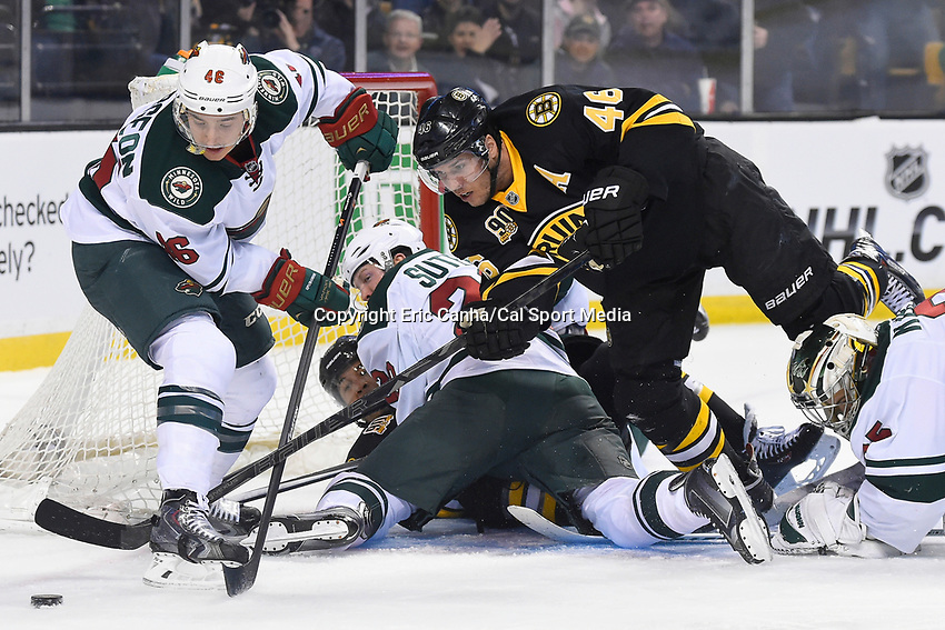 March 17, 2014 - Boston, Massachusetts , U.S. -  Boston Bruins center David Krejci (46) and Minnesota Wild defenseman Jared Spurgeon (46) battle for the puck during the NHL game between the Minnesota Wild and the Boston Bruins held at TD Garden in Boston Massachusetts.  Eric Canha/CSM