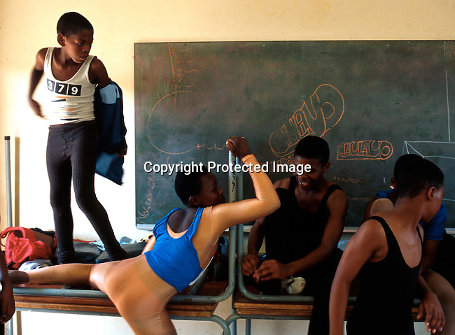 """Ballet dancers preparing for class on January 28, 2000 at Yomelela school  in Khayelitsha outside Cape Town, South Africa The """"Dance for All """", program started by the Cape Town City Ballet for unpriviliged children in the poor and destitute townships has helped hundreds of students to do something meaningful after school a few times a week.  .Photo: Per-Anders Pettersson/Agentur Focus"""
