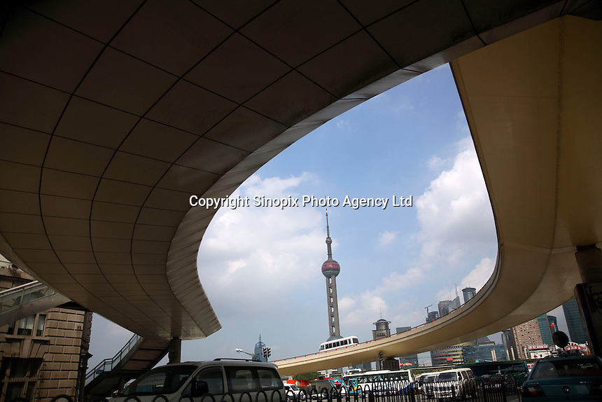 A view of the Pearl Oriental TV tower from an underpass in Shanghai, China..