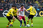 10.02.2018, Signal Iduna Park, Dortmund, GER, 1.FBL, Borussia Dortmund vs Hamburger SV, <br /> <br /> im Bild | picture shows:<br /> Filip Kostic (Hamburger SV #17) setzt sich gegen Manuel Akanji (Borussia Dortmund #16), Julian Weigl (Borussia Dortmund #33) und Shinji Kagawa (Borussia Dortmund #23) durch, <br /> <br /> <br /> Foto &copy; nordphoto / Rauch