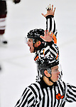 22 November 2011: NCAA Hockey East Referee Scott Whittemore motions a no-goal in the third period of play between the University of Vermont Catamounts and the University of Massachusetts Minutemen at Gutterson Fieldhouse in Burlington, Vermont. After review, the goal remained disallowed as University of Vermont Catamount forward H.T. Lenz was in the crease during the play. The Catamounts defeated the Minutemen 2-1 in their annual pre-Thanksgiving meeting of the Hockey East season. Mandatory Credit: Ed Wolfstein Photo