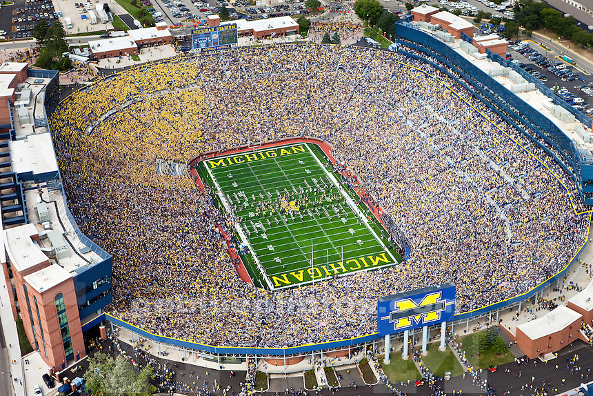 Under a banner of tradition, the Michigan Wolverines start a new era in Big House history. Prior to the rededication game against Connecticut the Wolverines charge from the tunnel and touch the MGoBlue banner for the first time in an improved Michigan Stadium.