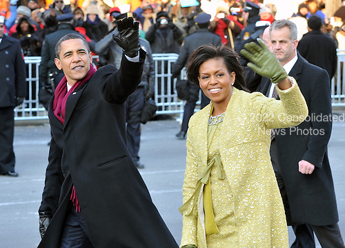 Washington, DC - January 20, 2009 -- United States President Barack Obama first lady Michelle Obama walk in the Inaugural Parade in Washington, D.C. on Tuesday, January 20, 2009..Credit: Ron Sachs - Pool via CNP