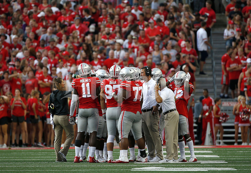 Ohio State defensive coordinator and linebacker coach Luke Fickell talks to his players during the second quarter of the NCAA football game between the Ohio State Buckeyes and the Tulsa Golden Hurricane at Ohio Stadium on Saturday, September 10, 2016. (Columbus Dispatch photo by Jonathan Quilter)