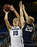 Nevada forward Zane Meeks (15) shoots over Colorado Christian guard Justin Engesser (20) during the first half of an NCAA college basketball game in Reno, Nev., Wednesday, Oct. 30, 2019.
