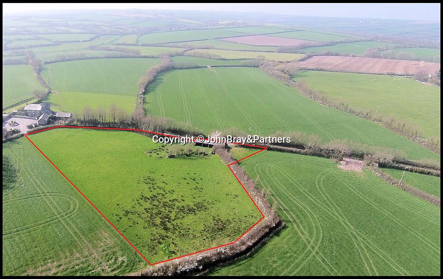 BNPS.co.uk (01202 558833)<br /> Pic:   JohnBray&Partners/BNPS<br /> <br /> Right Moooooove?.....<br /> <br /> Aerial view of the shed and land which it sits on.<br /> <br /> A dilapidated stone cow shed that has no front or side walls has gone on the market for a staggering £150,000.<br /> <br /> That is because the ruined barn has planning permission to turn it into a two bedroom cottage in a desirable part of Cornwall.<br /> <br /> The ramshackle outbuilding is on the edge of a farm in the village of Chapel Amble which is just five miles from the trendy resort of Rock.