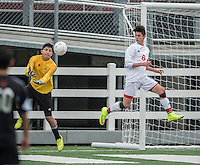 NWA Democrat-Gazette/ANTHONY REYES &bull; @NWATONYR<br /> Hugo Rodriguez, Springdale goalkeeper, collects the ball as Pablo Cortes (6) helps defend against Fort Smith Northside Thursday, March 19, 2015 at Bulldog Stadium in Springdale. The Bulldogs won on penalty kicks after a 2-2 tie at the end of regulation.