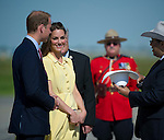 July 7, 2011 - Calgary, Alberta, Canada - Prince William and Catherine Middleton, Duchess of Cambridge, are greeted with white cowboy hats by Calgary Mayor Nenshi, as they arrive in Calgary. Calgary is the last Canadian stop of the British Royal Tour. Photo by Jimmy Jeong / Rogue Collective