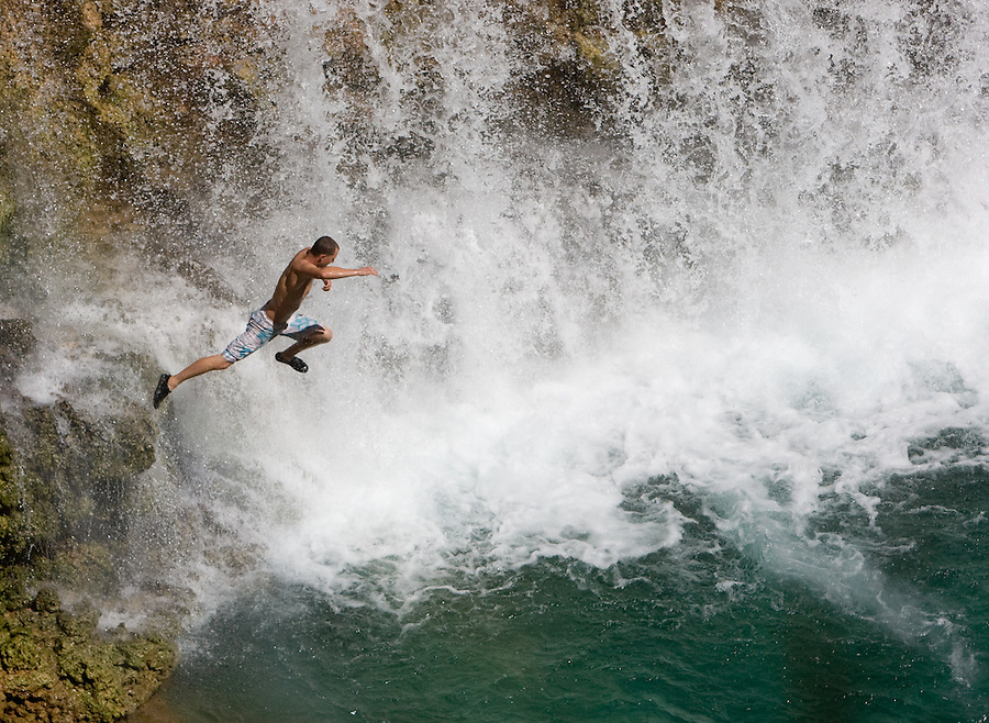8/2/09 Havasupai-- Joe Wallis, 27, of Prescott, jumps from a rock at Rock Falls, the new Havasupai waterfall created by the flash flood in .Havasu Canyon in August of 2008. Several of the Havasupai  waterfalls were damaged and changed in the flood. Over 25,000 people visit the falls every year. (Pat Shannahan/ The Arizona Republic)