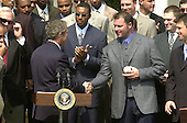 Washington, DC - May 4, 2001 -- U.S. President George W. Bush shakes hands with Pitcher Roger Clemens at the ceremony where he  welcomed the Major League Baseball 2000 World Champion New York Yankees to the White House.<br /> Credit: Ron Sachs / CNP