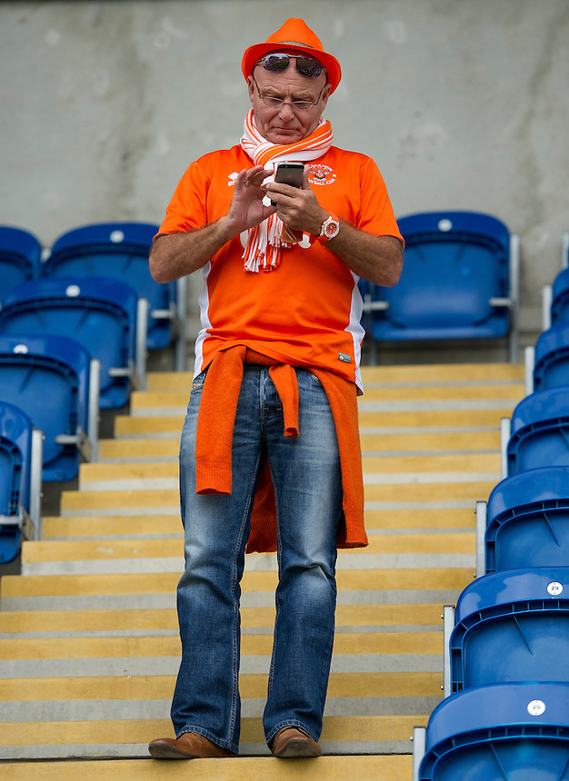 A Blackpool fan texting at the final whistle<br /> <br /> Photographer Ashley Western/CameraSport<br /> <br /> The EFL Sky Bet League Two - Colchester United v Blackpool - Saturday 10th September 2016 - Colchester Community Stadium - Colchester<br /> <br /> World Copyright &copy; 2016 CameraSport. All rights reserved. 43 Linden Ave. Countesthorpe. Leicester. England. LE8 5PG - Tel: +44 (0) 116 277 4147 - admin@camerasport.com - www.camerasport.com