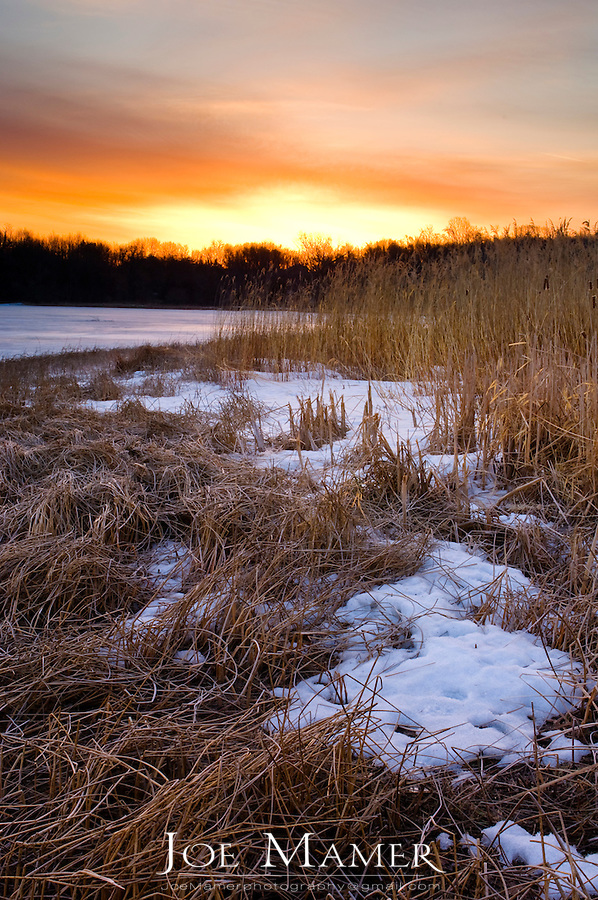 Sunrise over frozen lake Zumbra,  Minnesota.
